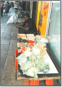 Frank Magwegwe hope on a fruit and vegetable stand